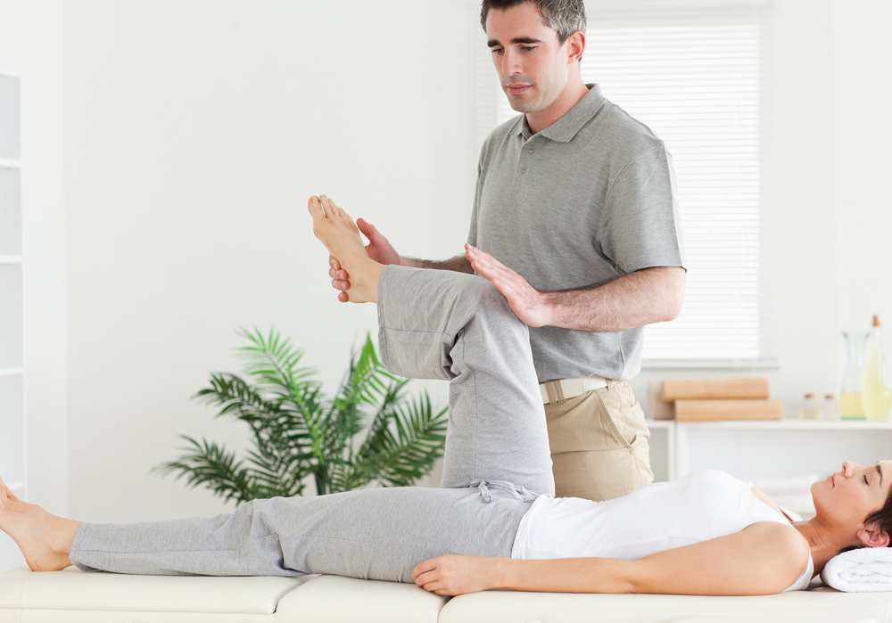 chiropractor helping his patient stretch